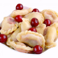 Dumplings with curd cheese, potato, cherries